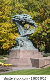Autumn in Lazienki park with monument of pianist Friderick Chopin, Warsaw, Poland