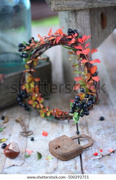 Autumn Leaves Berries Wreath On Wooden Stock Photo Edit Now 500292751