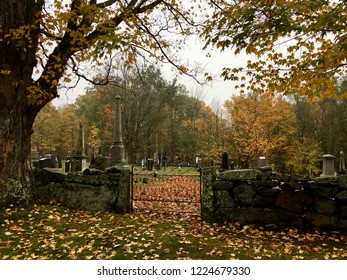 Autumn  leaves brighten up a rainy day at the old cemetery at the historical  Canterbury Shaker Village in Canterbury, New Hampshire.