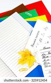 autumn leaves and colored paper for September 1
