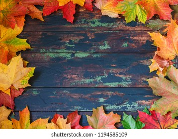 Autumn leaves frame, brown wooden background.Place for text.