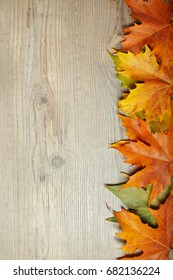 Autumn Leaves frame over wooden background