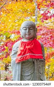 Autumn leaves and Jizo, Buddhist guardian deity of children
