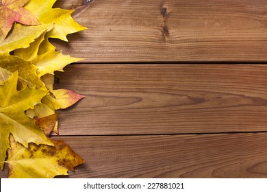 autumn leaves on old wooden background, wallpaper