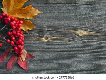 Autumn leaves  on wooden background top view texture