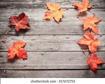 Autumn Leaves over wooden background - Shutterstock ID 317672753