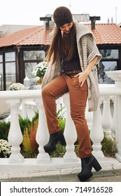 Autumn lifestyle fashion portrait of young stylish woman, wearing cute trendy casual outfit
