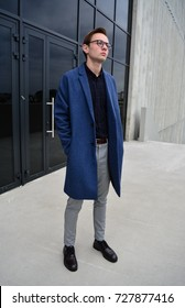Autumn look with blue coat and beige trousers