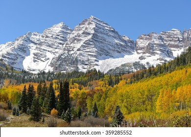 Autumn at Maroon Bells - Peaks of Maroon Bells surrounded by colorful autumn aspen grove and evergreen forest. Aspen, Colorado, USA.