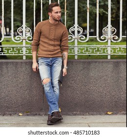 Autumn men's style . portrait of a young man outdoors.