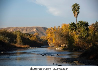 Autumn morning view of the Kern River as it flows through Bakersfield, California, USA.