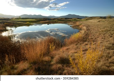 Autumn Mountain Pond - Sunset at a small pond in Bear Creek Trail Park, Denver-Lakewood, Colorado. USA