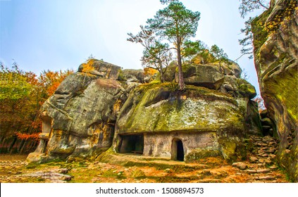 Autumn mountain rock town view. Ancient rock town in autumn. Autumn rock town cave view. Rock town cave in autumn