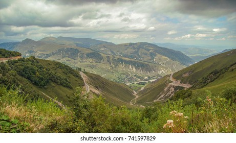 Autumn in the mountains of the North Caucasus. Scenic view of the village Harachoy and gorges of the Hulkhulau river on the background of the dramatic sky. Nature and travel. Russia, Chechnya