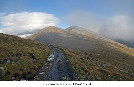 autumn Nizke Tatry mountains near sedlo Polany mountain pass in Slovakia with hiking trail, hills covered
