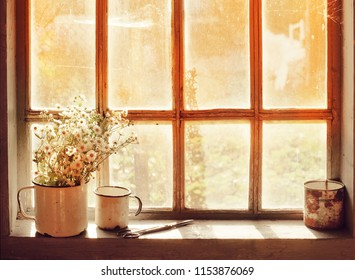 autumn nostalgic background with rustic window and flowers