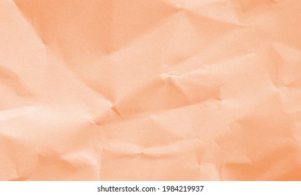autumn orange colored crumpled paper texture background for design, decorative.