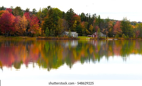Autumn Painting A New England cottage along with the foliage getting beautifully reflected on the still waters
