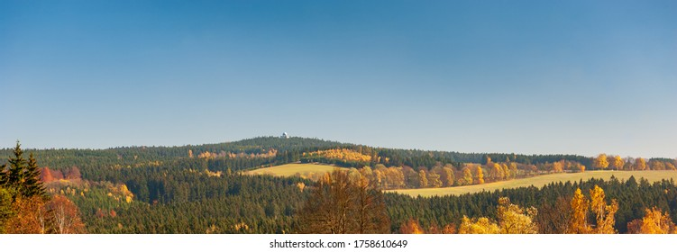 Autumn panorama of Bucht Hill (Buchtuv Kopec). Colorful forests and fields of Bohemian Moravian Highlands, Zdar Hills, Vysocina, Czech Republic.