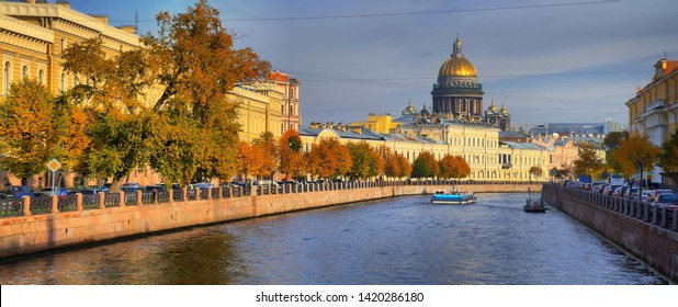 Autumn panorama of the embankment of the Moika river and St. Isaac's Cathedral in Saint-Petersburg