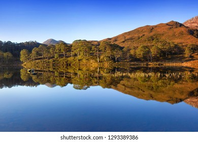 Autumn panorama of Loch Claire with the views of Beinn Eighe and Liathach from across the water. Glen Torridon, Highlands, Scotland, UK Beautiful landscape reflection in water