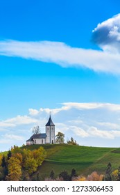 Autumn panorama with Saints Primus and Felician Church on top of hill in Slovenian countryside, Slovenia