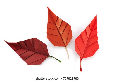 Autumn paper origami leaves on white background