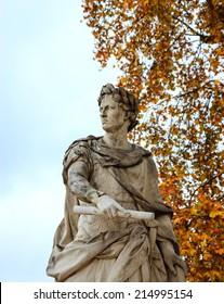 Autumn in Paris. Julius Caesar marble statue in Tuileries gardens.