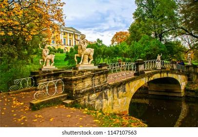 Autumn park bridge in Pavlovsk, Russia.  Pavlovsk park bridge in autumn season. Autumn park river bridge landscape