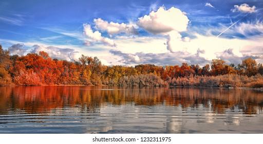 autumn park by the lake. Blue sky