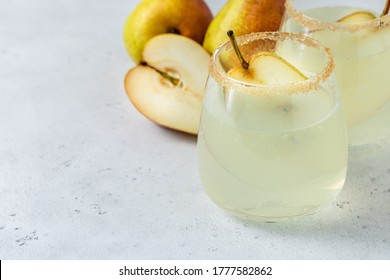 Autumn pear cider cocktail. Space for text.