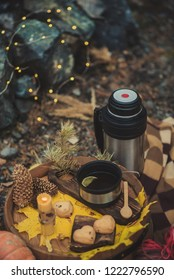 Autumn picnic by the fire in nature: coffee pot, waffles, fire, stylishly served in the style of hugge.