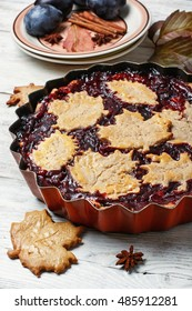 Autumn pie with plum decorated cakes in the form of leaflets