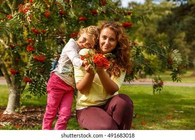 Autumn portrait with ashberry