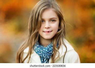 Autumn portrait of beautiful 6 year girl