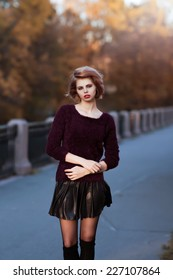 Autumn portrait of a blonde girl in black sweater