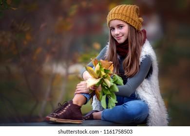 Autumn portrait of cute girl outdoors