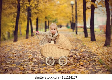 Autumn portrait of a cute little girl