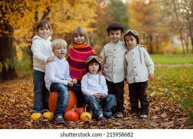 Autumn portrait of group of happy kids, outdoor