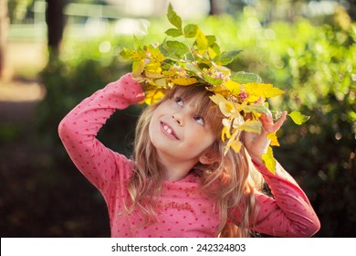 Autumn - portrait of lovely girl in autumn park
