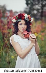 autumn portrait of romantic woman with flowers in her hair