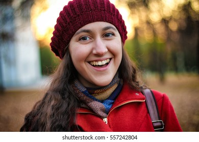 Autumn portrait of a very happy young stylish woman.