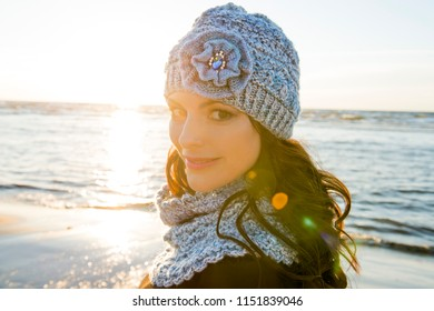 Autumn portrait of the woman in a knitted hat and a handmade scarf