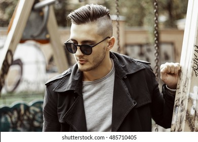 Autumn portrait of a young man with trendy hairstyle.