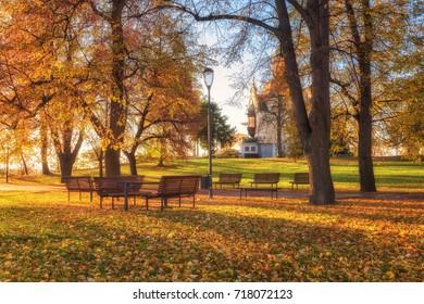 Autumn in Prague (Praha), beautiful Letna park (Letenske sady) in sunlight, sunny landscape, popular tourist destination, Czech Republic - Shutterstock ID 718072123