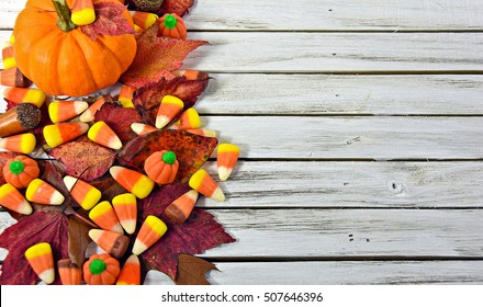 autumn pumpkin and candy corn on gray wood