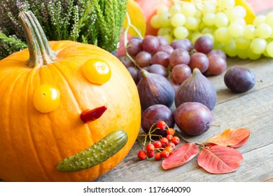 Autumn pumpkin fun background with colorful leaves and fruits and vegetables