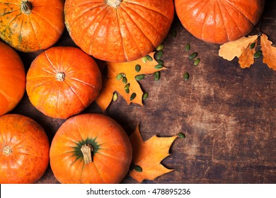 Autumn Pumpkin Thanksgiving Background - orange pumpkins over wooden table