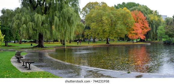 Autumn rain in Boston Public Garden. Park pathway, pond and beautiful grounds