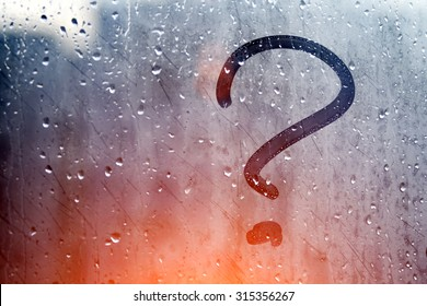 Autumn rain, the inscription on the sweaty glass - question mark